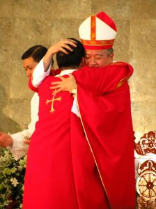 Bishop bearhugs Jhoen